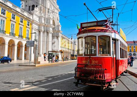 LISBON, PORTUGAL - MARCH 17: Old tram in the Praca do Comercio on March 17, 2014 in Lisbon, Portugal. Tram is the traditional form of public transport