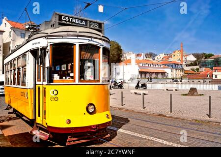 LISBON, PORTUGAL - MARCH 18: A typical tram 28 in Alfama district on March 18, 2014 in Lisbon, Portugal. The 28 line is one of the most used by touris