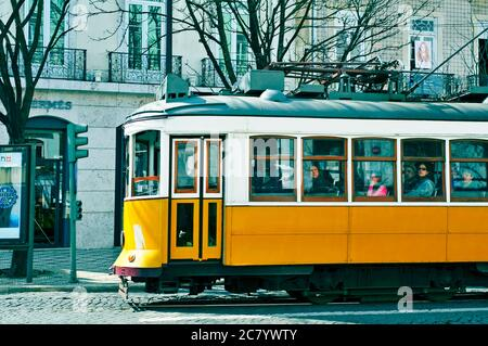 LISBON, PORTUGAL - MARCH 18: A typical yellow tram in Chiado district on March 18, 2014 in Lisbon, Portugal. The tramway is the most popular mode of t