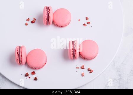 pink Macaroni cookie French on white plate. Studio photo - Stock Photo
