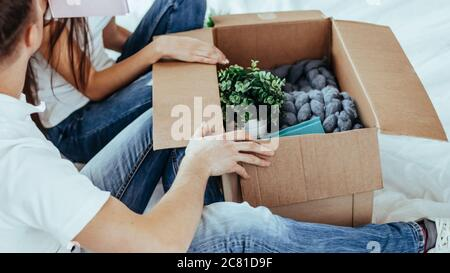 close up. couple opening a large cardboard box.