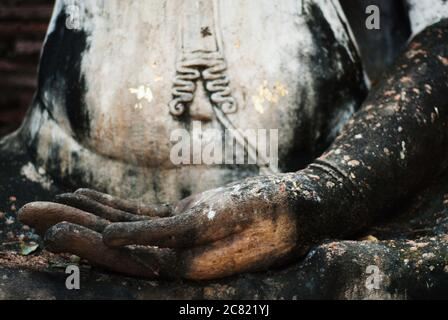 Close up of buddha's hand in the Ancient Buddhist ruins in Sukhothai Historical Park in Sukhothai Province, Thailand, Southeast Asia