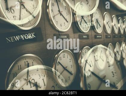 World wide time zone clock. Clocks on the wall, showing the time around the world. Stock Photo