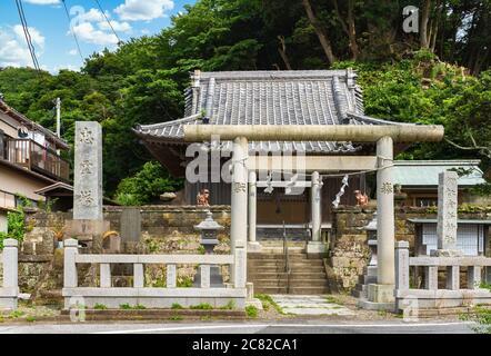 chiba, japan - july 18 2020: Torii gate of the shintoist Kanaya Shrine dedicated to the god of metal Kanayama Hikonokami at the foot of the stone quar