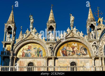 St Mark`s Basilica or San Marco close-up, Venice, Italy. It is top landmark in Venice. Beautiful Christian mosaic of luxury cathedral exterior, detail - Stock Photo