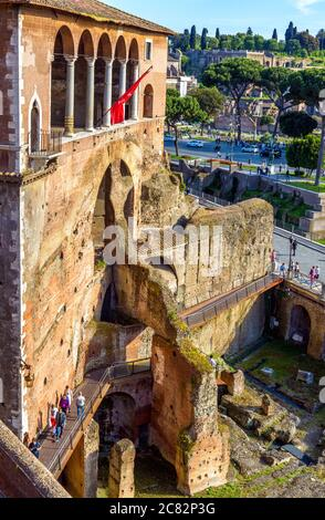 Rome - May 8, 2014: People visit House of Knights of Rhodes on Forum of Augustus, Rome, Italy. Old famous building in Roma center, tourist attraction - Stock Photo
