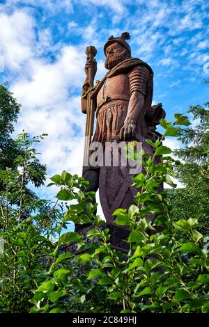 Red sandstone statue of the Scottish knight William Wallace - Stock Photo