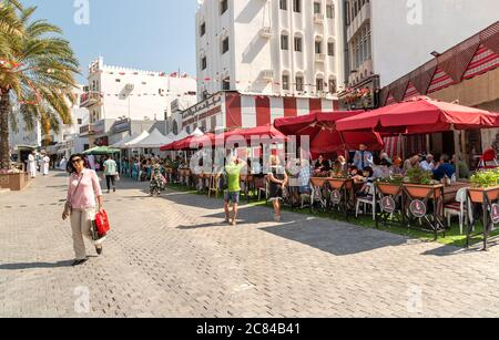 Mutrah, Oman - February 10, 2020: People enjoying a outdoor bars and restaurants in the center of Mutrah in a hot day, province of Muscat, Sultanate o