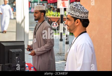 Mutrah, Oman - February 10, 2020: Profile of young Omani man in traditional Omani clothing in the street in Mutrah, Sultanate of Oman, Middle East