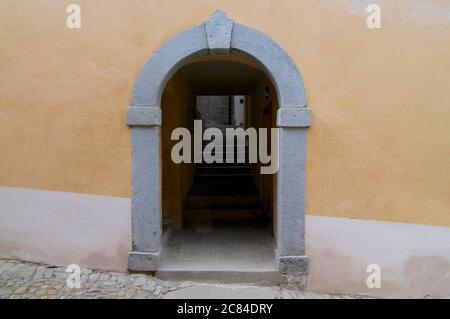 Typical view of an alley entrance taken in the old village center of Bigorio in the Capriasca region in the Canton of Ticino, Switzerland