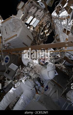 NASA astronaut Robert Behnken works during the Wednesday, July 1, 2020, six-hour and one-minute spacewalk to swap an aging nickel-hydrogen battery for a new lithium-ion battery on the International Space Station's Starboard-6 truss structure. NASA astronauts Chris Cassidy and Behnken concluded their spacewalk at 12:14 p.m. EDT. During the spacewalk, the two NASA astronauts completed half the work to upgrade the batteries that provide power for one channel on one pair of the station's solar arrays. The new batteries provide an improved and more efficient power capacity for operations. NASA/UPI - Stock Photo