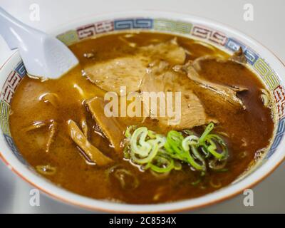 Asahikawa, Hokkaido, Japan - Shoyu Ramen, Japanese traditional noodle soup with a clear brown broth, based on beef and vegetable stock with soy sauce.