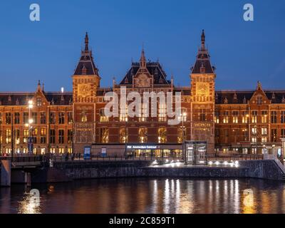 Amsterdam, Netherlands - October 15 2018: The outside of Amsterdam's Centraal during the early evening.