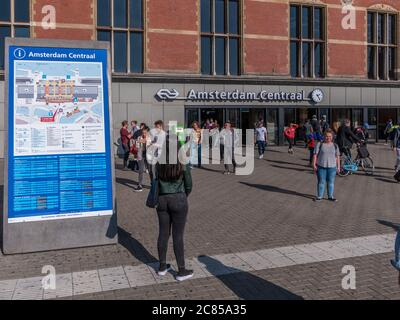 Amsterdam, Netherlands - October 15 2018: Commuters and tourists make their way in and out of Centraal Station in Amsterdam.