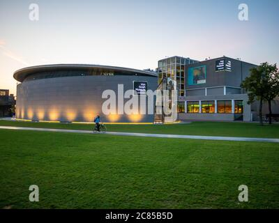 Amsterdam, Netherlands - October 15 2018: The outside of the Van Gogh Museum from Museumplein during the early evening.