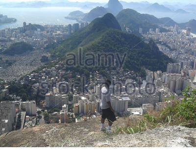 man looking at the Copacabana district of the goats the hill ( morro dos cabritos ) in Rio de Janeiro, Brazil. - Stock Photo