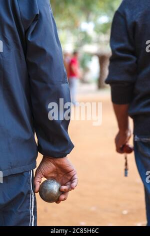 Two men playing a traditional game with metallic balls called 'Abali' (in other countries is called 'petanque'), in Preveza town, Epirus, Greece,