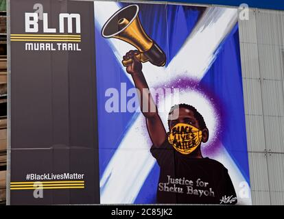 Usher Hall, Edinburgh, Scotland, UK. The Black Lives Matter trail has a new addition in the City Centre, the newest piece of artwork on the trail is a massive 5.5 meter x 6.5 metre print which has appeared on the front of Edinburgh's Usher Hall. A tribute to Fife's Sheku Bayoh who died in 2015 at the hands of Scots police and was created by Kirkcaldy artist Abigail Mill who wanted to express her mixed Scottish and Jamaican heritage. There are also other examples of the artist's work behind glass in the display boards in front of the venue. Credit: Arch White/Alamy Live News. - Stock Photo