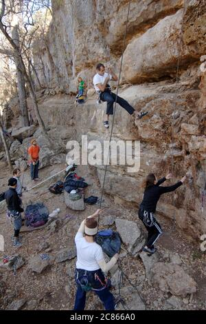Spicewood, TX. December 23, 2005:  Rock climbers practice at Reimer's Ranch County Park, Travis County, TX in the Hill Country west of Austin.  The limestone cliffs are popular with Texas climbers.   ©Bob Daemmrich - Stock Photo