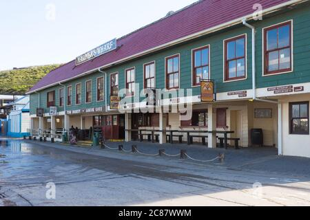 Mariners Wharf fish market building at Hout Bay harbour in Cape Town, South Africa
