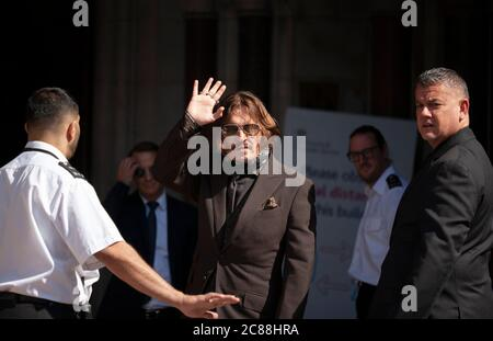 London, UK. 22nd July 2020. Actor Johnny Depp waves to his fans and the media as he arrives at the Royal Courts of Justice for day 12 of his libel trial against The Sun's publishers NGN. Credit: Neil Atkinson/Alamy Live News Stock Photo