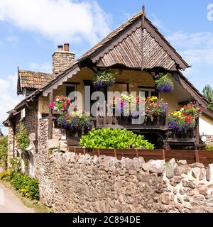 A Swiss chalet style balcony on an old stone cottage on Exmoor National Park in the village of Bossington, Somerset UK