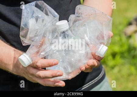 Man holding crushed plastic bottles in his hands, Concept, Eco friendly lifestyle, Zero Waste