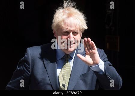 London, UK. 22nd July, 2020. British Prime Minister Boris Johnson (L) leaves 10 Downing Street for Prime Minister's Questions at the House of Commons in London, Britain on July 22, 2020. Credit: Ray Tang/Xinhua/Alamy Live News Stock Photo