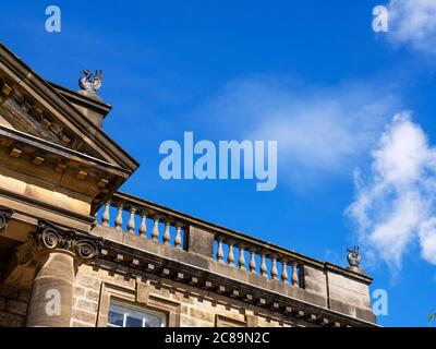 Architecture detail at Conyngham Hall showing balustraded parapet with phoenix finials Knaresborough North Yorkshire England - Stock Photo