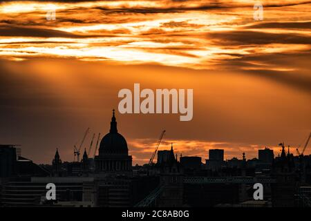 London, UK. 22nd July, 2020. UK Weather: Dramatic evening sun rays over the city skyline including St. Paul's Cathedral. Credit: Guy Corbishley/Alamy Live News Stock Photo