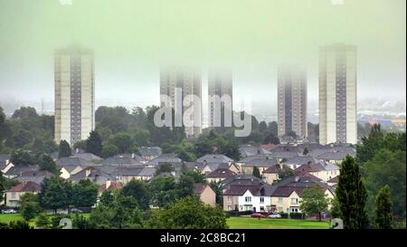 Glasgow, Scotland, UK 23rd July, 2020: UK Weather: Foggy start mist and rain saw low level cloud cap the tops of the Scotstoun towers over the knightswood semi detached as the south of the city disappeared in the mist. Credit: Gerard Ferry/Alamy Live News - Stock Photo