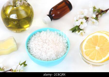 Natural Ingredients for Homemade Body Salt Scrub Lemon, Sea salt and Olive oil. Skincare Organic. - Stock Photo