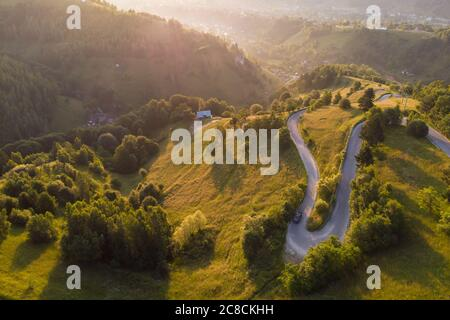 Aerial landscape of mountain winding road, in Transylvania