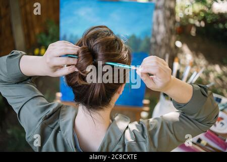 Close-up view of hair bun made with paintbrush