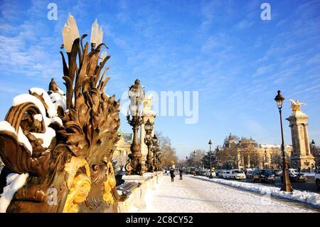 Paris under snow. View of Alexandre III Bridge. Grand Palais and Petit Palais buildings at background. - Stock Photo