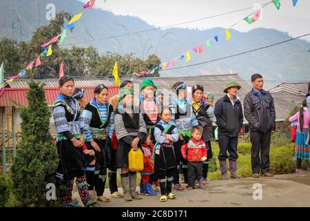 Sapa, Vietnam - January 16th 2014: Hmong tribe on a cold winters morning in Sapa, Vietnam - Stock Photo