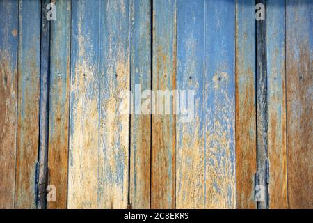 Weathered wood texture background with faded blue paint and abstract patterns from a timber house in Thailand. - Stock Photo
