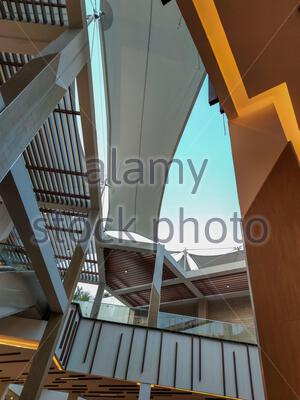 electric mall stairs going up and down - Stock Photo