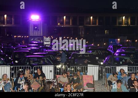 Munich, Germany. 23rd July, 2020. Spectators in deck chairs and cars recorded at the film premiere ' Faking Bullshit' in the PopUp drive-in cinema at the Filmfest München Pop-Up. Credit: Ursula Düren/dpa/Alamy Live News - Stock Photo