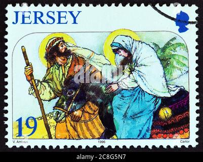 JERSEY - CIRCA 1996: A stamp printed in United Kingdom from the 'Christmas' issue shows The Journey to Bethlehem, circa 1996.