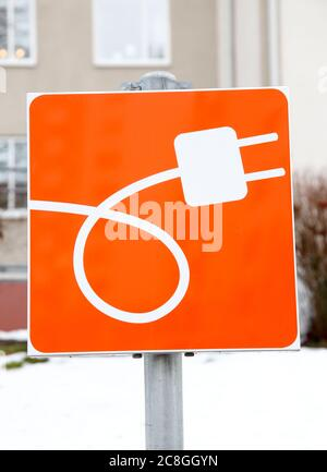 Charging pole, for electric car, at a parking lot. Photo Jeppe Gustafsson - Stock Photo