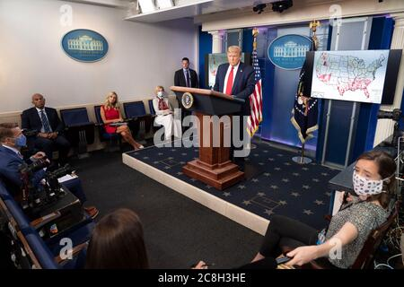 Washington, United States Of America. 23rd July, 2020. Washington, United States of America. 23 July, 2020. U.S. President Donald Trump listens to a question from a reporter during an update briefing on the COVID-19, coronavirus pandemic in the Briefing Room of the White House July 23, 2020 in Washington, DC Credit: Shealah Craighead/White House Photo/Alamy Live News - Stock Photo