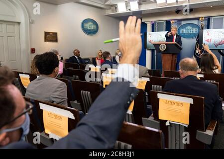 Washington, United States Of America. 23rd July, 2020. Washington, United States of America. 23 July, 2020. U.S. President Donald Trump takes a question from a reporter during an update briefing on the COVID-19, coronavirus pandemic in the Briefing Room of the White House July 23, 2020 in Washington, DC Credit: Shealah Craighead/White House Photo/Alamy Live News - Stock Photo