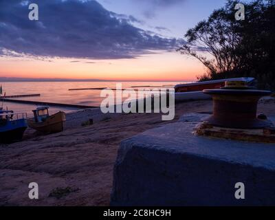 fishing boats at the beach of the Baltic Sea shortly befor sunrise