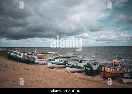 At the beach of Jaroslawiec in Poland fishing boats lie on the beach of the Baltic Sea