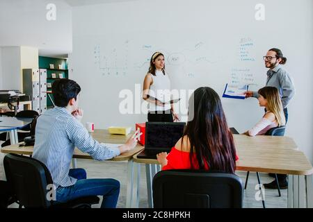young latin woman working at office or creative teamwork, Mexican people in Mexico city