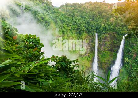 Stunning view of Tad Fane waterfall in the morning mist, great twin waterfall in the mist, travel destinations in South Laos.