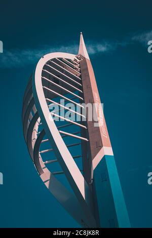 A view looking up at the Emirates spinnaker tower at Gunwharf quays Portsmouth with a Bright blue sky in the background - Stock Photo