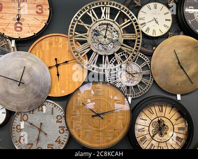 Venlo, Netherlands - July 9. 2020: View on group of various isolated round vintage clocks on wall - Stock Photo