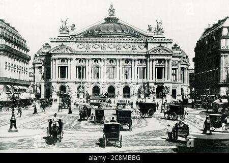 This photo dates to around 1902 and shows the Grand Opera House in Paris, France. ThePalais Garnier(Garnier Palace orOpéra Garnier) is a 1,979-seat opera houseat thePlace de l'Opérain the9th arrondissementof Paris, France. It was built for theParis Operafrom 1861 to 1875 at the behest of EmperorNapoleon III.Initially referred to as 'le nouvel Opéra de Paris' (the new Paris Opera), it soon became known as the Palais Garnier,'in acknowledgment of its extraordinary opulence'and the architectCharles Garnier's plans and designs, which are representative of theNapoleon III style - Stock Photo